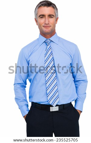 Cheerful businessman with hands in pocket posing on white background - stock photo