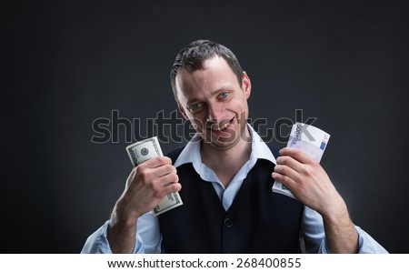 Cheerful businessman with money - stock photo