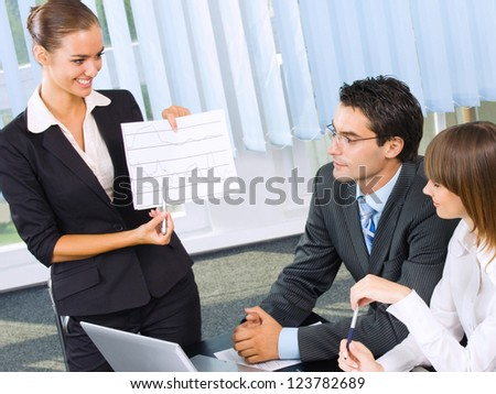Cheerful businesspeople at business meeting, seminar, conference or training