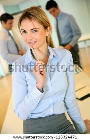 Cheerful businesswoman attending seminar - stock photo