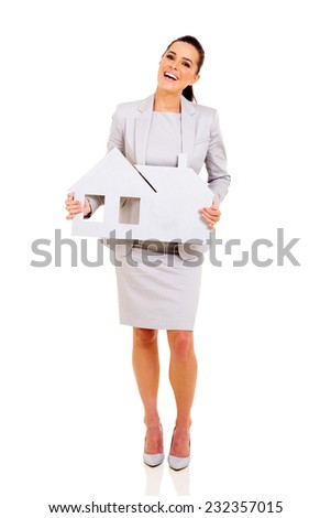 cheerful businesswoman holding paper house on white background - stock photo