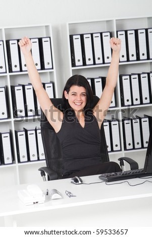 cheerful businesswoman in office - stock photo