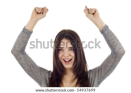 Cheerful businesswoman with clenched fist - stock photo