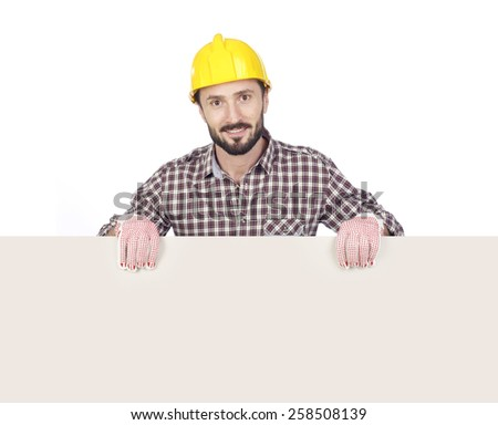 Cheerful carpenter holding a blank board, white background - stock photo