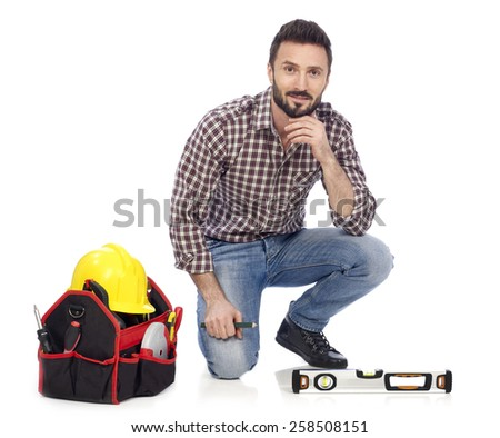 Cheerful carpenter looking at camera, white background - stock photo