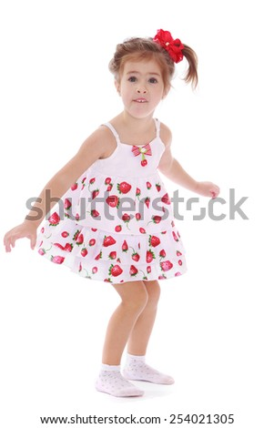 cheerful caucasian girl in a light summer dress.Isolated on white. - stock photo