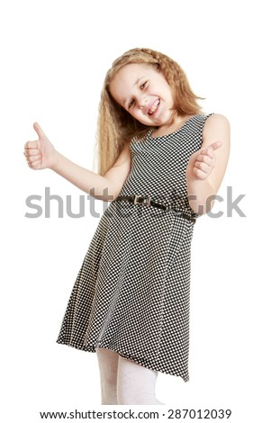 Cheerful Caucasian girl makes a hand gesture raising her thumbs up-Isolated on white background - stock photo