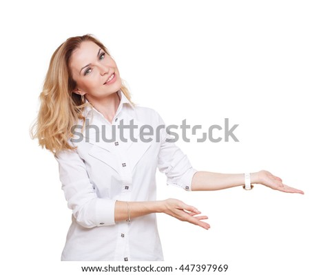 Cheerful caucasian lady showing something isolated at white background. Blond middle-aged attractive woman looking at camera, pointing at nowhere with copy space - stock photo