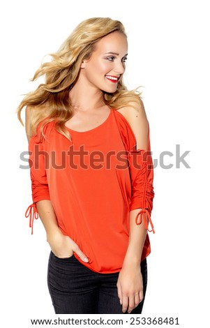 Cheerful Caucasian woman posing in bright red coral top. - stock photo