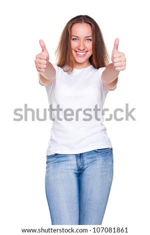 cheerful caucasian woman showing thumbs up. model in white t-shirt and blue jeans posing over white background - stock photo