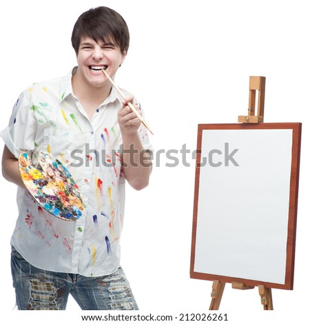 cheerful caucasian young male painter standing isolated on white - stock photo