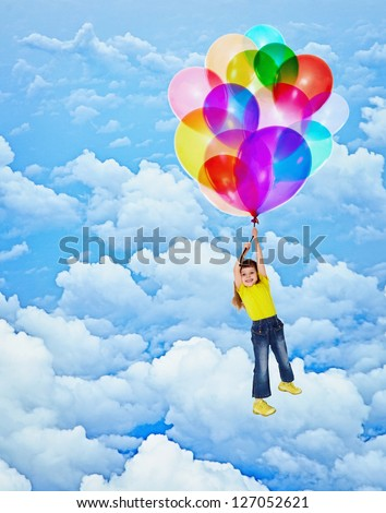 Cheerful child flies with balloons on the sky background - stock photo