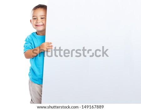 cheerful child hidden behind a white banner - stock photo