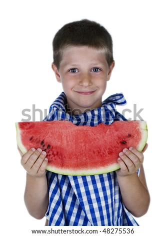 Cheerful child holding a watermelon slice - stock photo