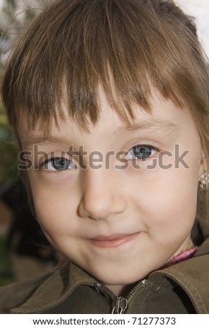 Cheerful child in a kindergarten summer, looking of camera