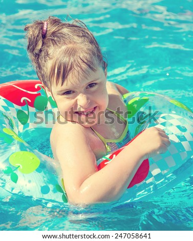 Cheerful child is bathed in seawater - stock photo