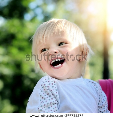 Cheerful Child laugh in the Summer Park - stock photo