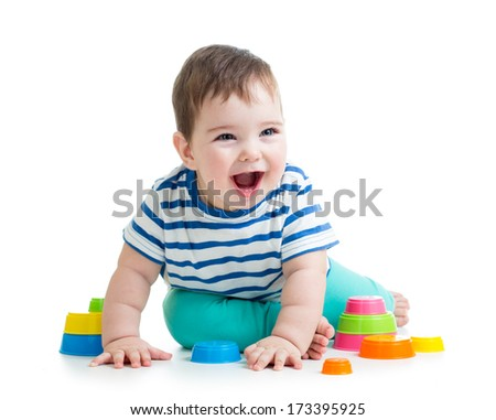 cheerful child playing with colorful toy isolated on white - stock photo
