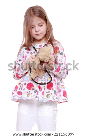 cheerful child playing with toy over white background - stock photo