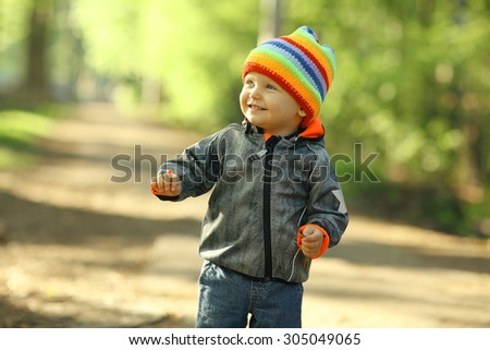 cheerful child walks in the park - stock photo