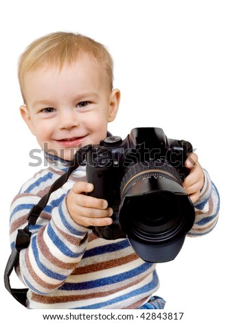 Cheerful child with a camera - stock photo