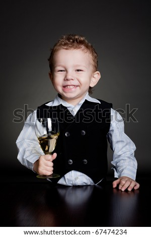 cheerful child with a glass - stock photo