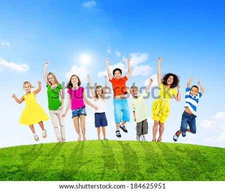 Cheerful Children and WomenJumping On a Hill