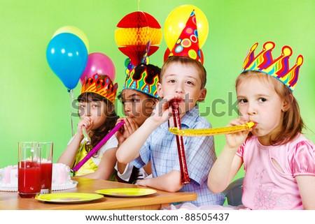 Cheerful children having fun at birthday party - stock photo