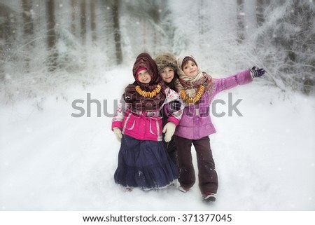 cheerful children in the winter afternoon   - stock photo