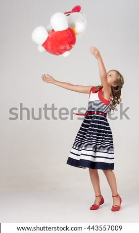 cheerful children play and toss soft toy bear - stock photo
