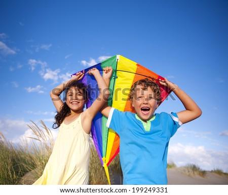 Cheerful Children Playing Kite Outdoors - stock photo