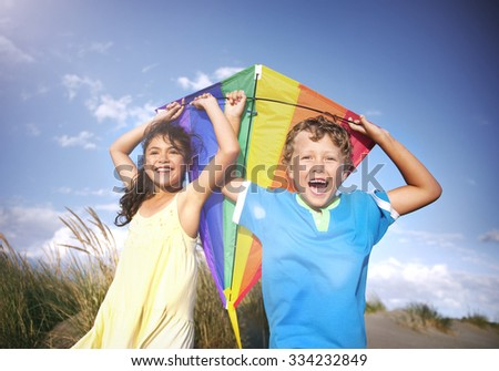 Cheerful Children Playing Kite Outdoors Happiness Concept - stock photo