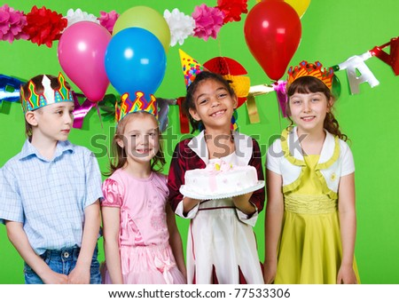 Cheerful children with the  birthday cake