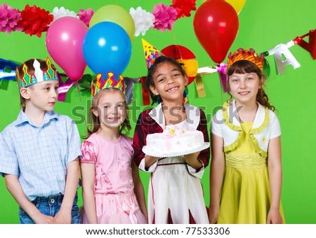 Cheerful children with the  birthday cake - stock photo