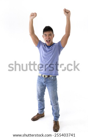 Cheerful Chinese man celebrating with his arms up. Isolated on white background. - stock photo