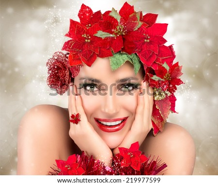 Cheerful christmas girl. Festive makeup, manicure and floral hairstyle in red and green. Beauty fashion christmas. Happy people - stock photo