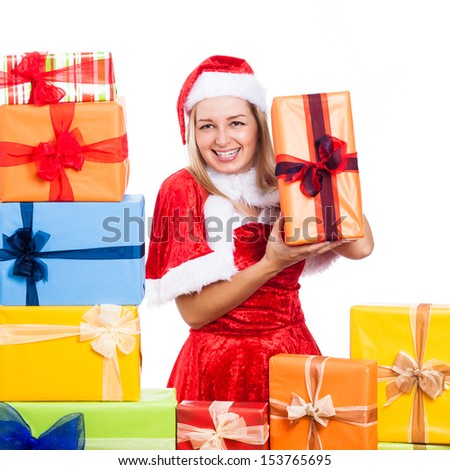Cheerful Christmas woman with many presents, isolated on white background. - stock photo