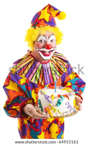 Cheerful clown offering a birthday cake to you.  Isolated on white.