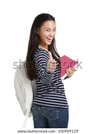 cheerful college student turning back and showed thumbs up - stock photo