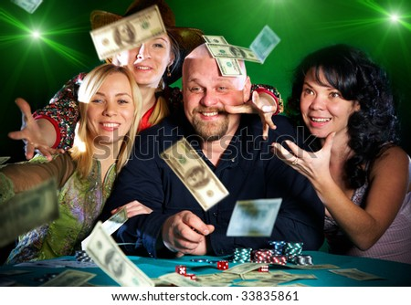 cheerful company of friends. prize of money... - stock photo