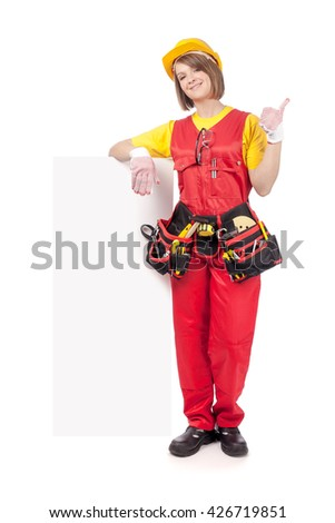 cheerful construction female worker showing thumb up and holding blank board with empty copy space for you text isolated on white background. advertisement banner. your text here - stock photo
