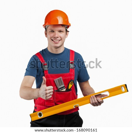 Cheerful construction worker in uniform and hardhat with special tools - stock photo