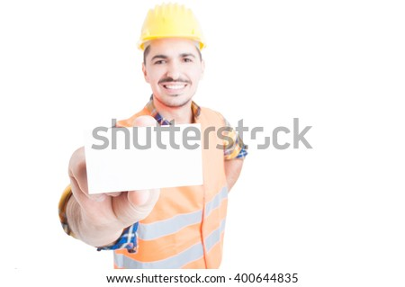 Cheerful constructor showing blank or empty visit card in close-up with advertising area isolated on white - stock photo