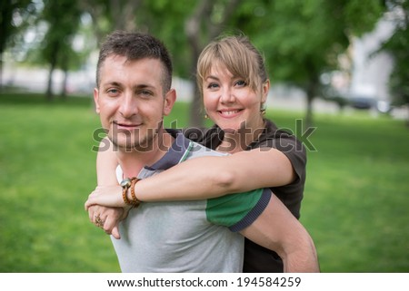 Cheerful couple being happy to spend summer vacation together - stock photo
