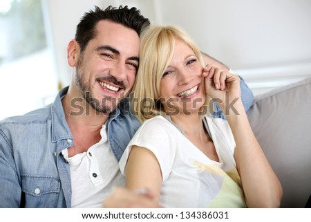 Cheerful couple having fun - stock photo