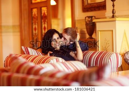 Cheerful couple having fun in a beautiful room - stock photo
