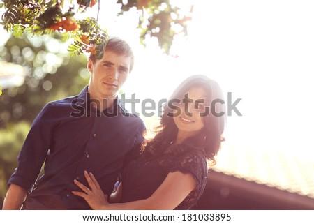 Cheerful couple having fun in sunlight - stock photo