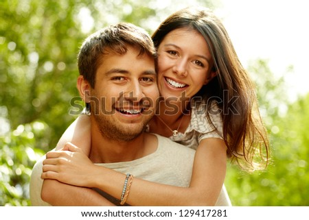 Cheerful couple having fun on summer vacation - stock photo