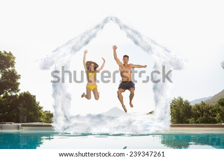 Cheerful couple jumping into swimming pool against house outline in clouds - stock photo