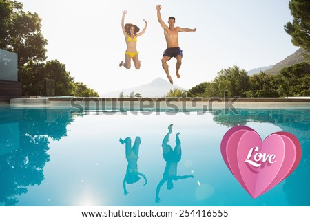 Cheerful couple jumping into swimming pool against love heart - stock photo